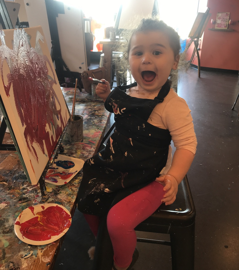 kid excited painting